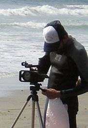 Kai filming on beach